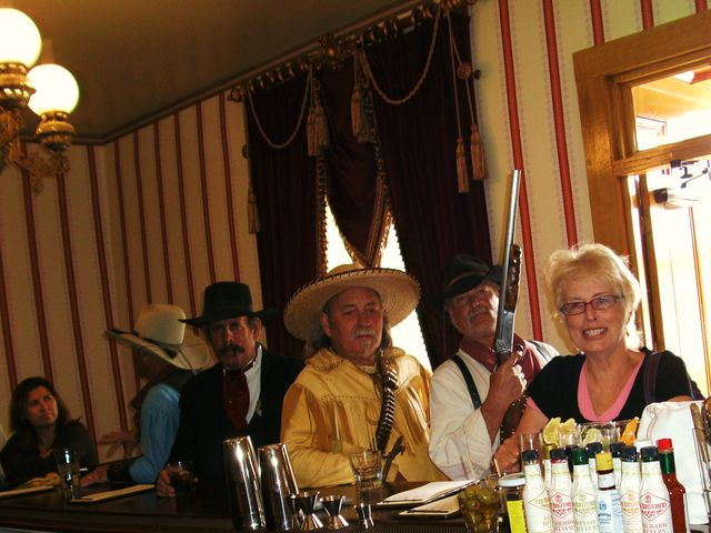 OUTLAWS HELPING IN THE SALOON